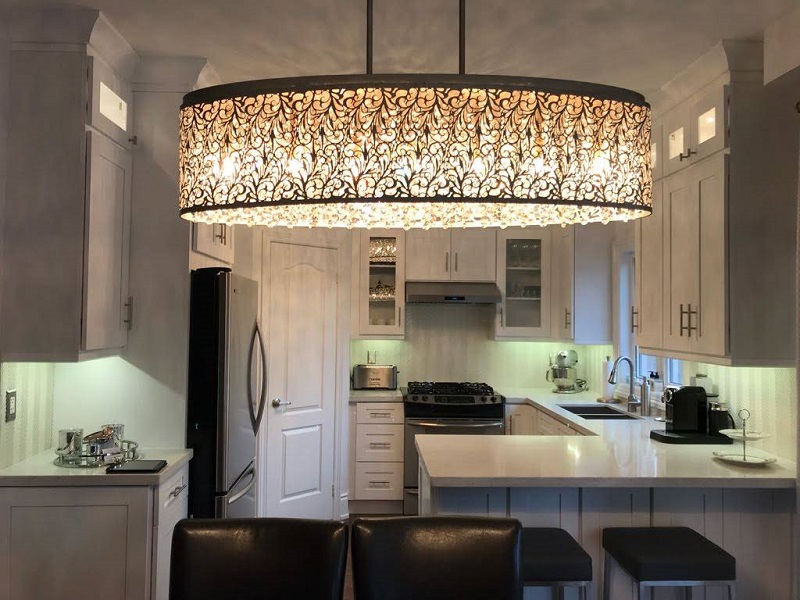 Renovated small kitchen in New York with fancy lighting